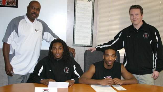Several North Idaho College men's basketball players recently signed with NCAA schools. Pictured are NIC Athletics Director Al Williams, Lateef Williams who signed with Northwest Nazarene University, Melvin Jones who signed with Portland State University
