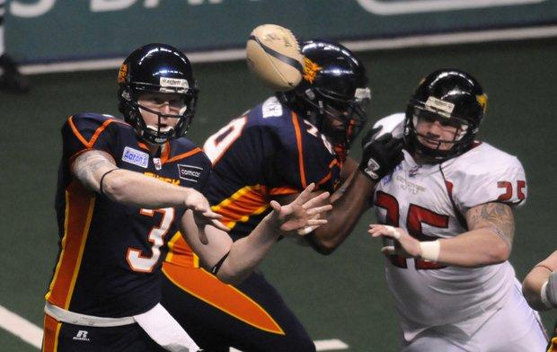 Spokane's Casey Hansen, left, filled in briefly for quarterback Nick Davila.  (Photo: Jesse Tinsley / The Spokesman-Review )