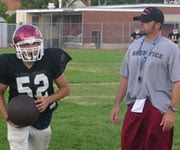 North Central coach Brian Gardner looks over his offensive line during practice (Photo: SWX)