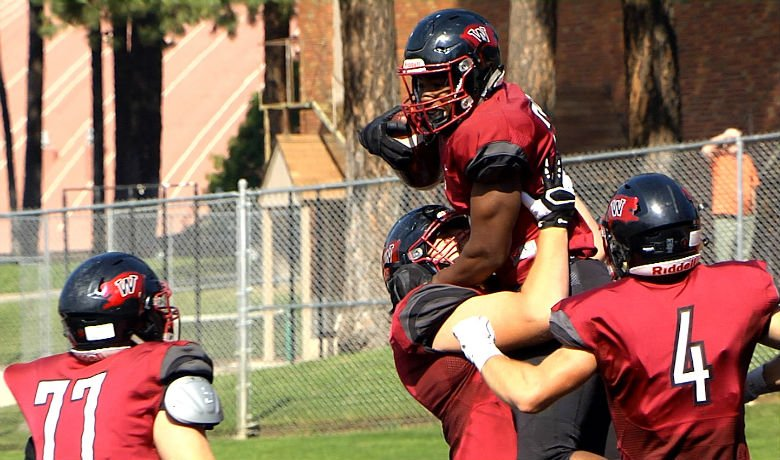 Kolste throws for 4 TD passes leading Whitworth to victory.