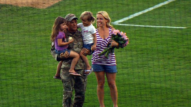 Sergeant Chris Weichman surprised his wife and twin girls at the Spokane Indians game on Monday (Photo: SWX)