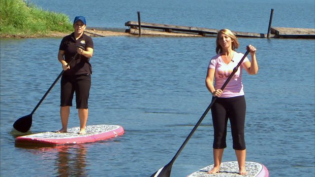 Leslie Lowe (right) and Michelle Dapper (left) learn paddle boarding on Fernan Lake (Photo: SWX)