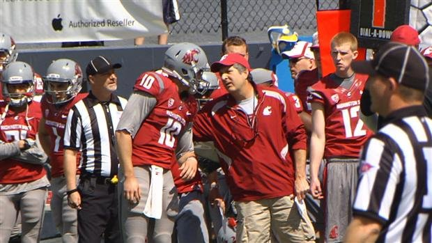 Quarterback Jeff Tuel gets a little instruction from coach Mike Leach during Saturday's scrimmage. (Photo: SWX)