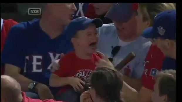 A young boy broke out into tears after the couple next to him grabbed a baseball a player had tossed into the stands.