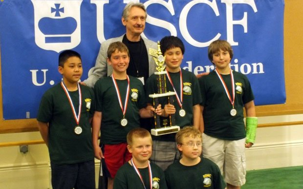 Northwest Christian Chess Team at the National Tournament with their coach, John Dill (Dill Media)