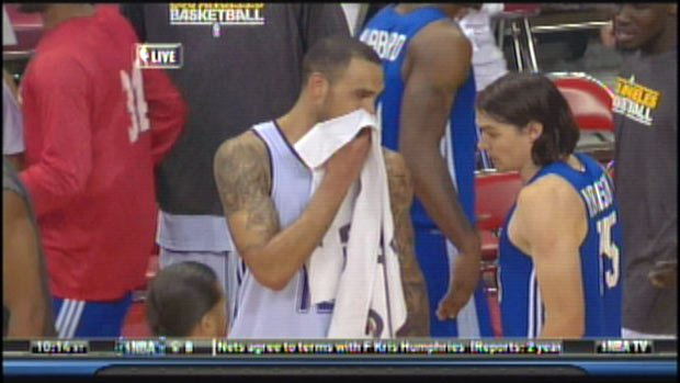 Rob Sacre and Adam Morrison exchange words following Thursday's game in Las Vegas. (Courtesy: NBATV)