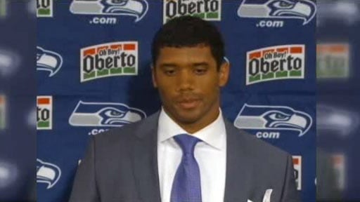  Russell Wilson was sacked three times and intercepted once in his first regular season game in the NFL (Photo Courtesy: KIRO)