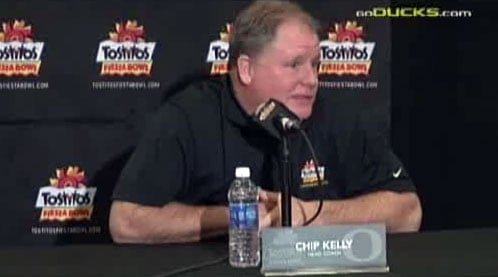 Chip Kelly tried to turn reporters' attention away from the fact he is reportedly being wooed by NFL teams.