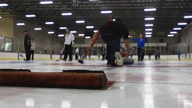 Locals were able to try curling at the Frontier Ice Arena on Monday.