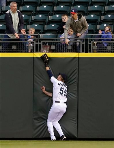 Michael Saunders hurt his shoulder making a catch on Wednesday. (Photo courtesy of AP)