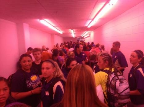 The UW softball Twitter account (@UWSoftball) tweeted this picture of the team huddling for safety in the hotel basement while a tornado passed through the Oklahoma City area.