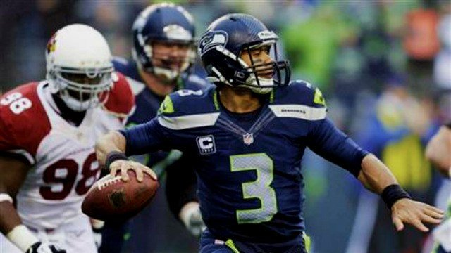 Courtesy Elaine Thompson/ AP Photo: Russell Wilson looks to lead his Seahawks past the Saints again this weekend.