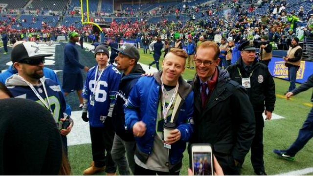 Fox play-by-play man, Joe Buck, with rapper Macklemore before the NFC Championship game.