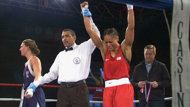 Olympic medalist and the Lightweight division National Champion Queen Underwood celebrates her victory on Saturday.
