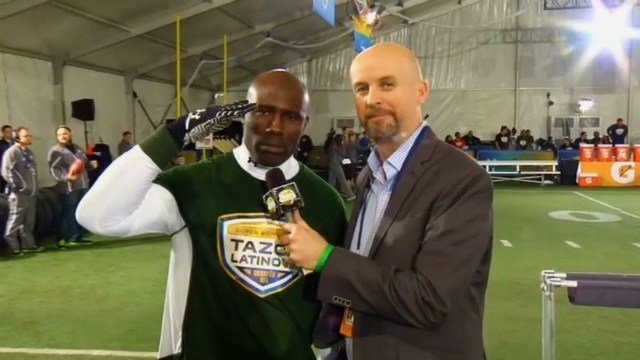 Sam Adams interviews former Denver Broncos great Terrell Davis before the Super Bowl XLVIII Skills Challenge.