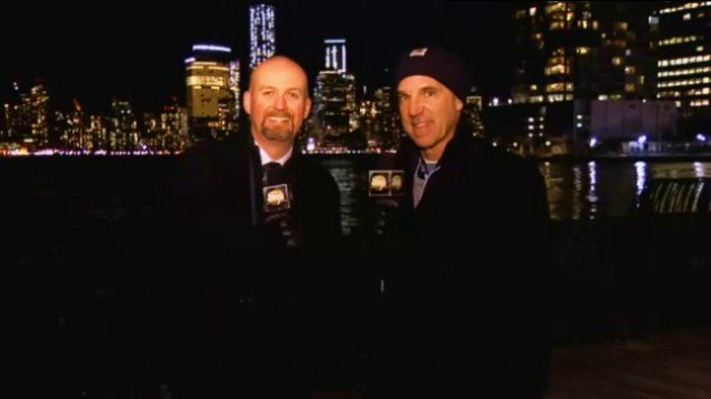 Sam Adams with former Seattle Seahawks QB Dave Kreig on the shore of the Hudson River.