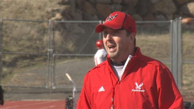 EWU head coach Beau Baldwin was in full voice as the Eagles took the field for the first time in 2014.