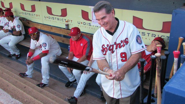 Steve Garvey admiring one of the bats before throwing out the first pitch at Avista Stadium.