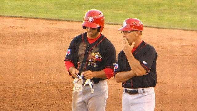 Canadians left fielder Chris Carlson adjusting his batting gloves in Vancouver's 11-6 win on Tuesday night.