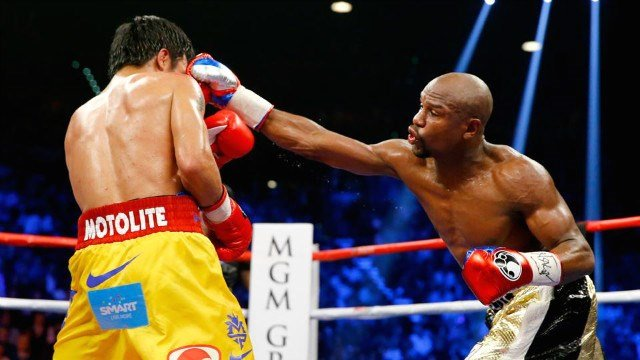 Floyd Mayweather Jr. moved to 48-0 in a unanimous decision over Manny Pacquiao. (Photo: Twitter/SI)