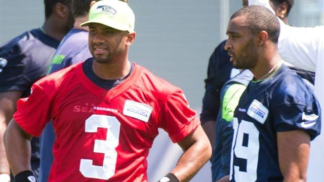 Russell Wilson and Doug Baldwin talk on the sideline during the Seahawks OTAs. (Photo: Seahawks)
