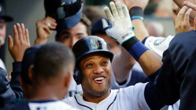 Robinson Cano celebrates his first homer since April in the dugout. (Photo: ESPN/AP)
