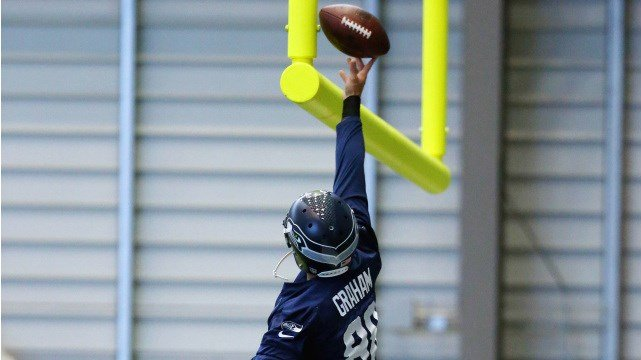 Jimmy Graham takes a crack at his iconic dunk after a catch during the Seahawks OTAs. (Photo: Seahawks)