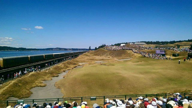 The 17th green at Chambers Bay as the train goes by on day three of the 115th U.S. Open. (Photo: Sam Adams)