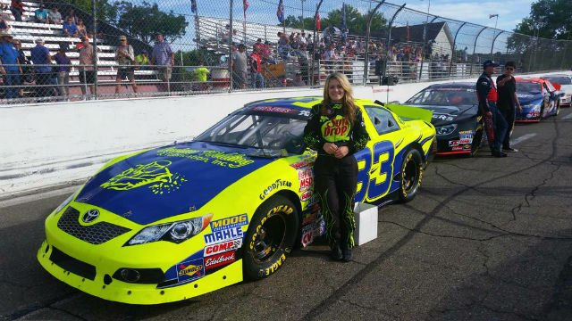 Local NASCAR K&N Pro Series driver Nicole Behar with her car before a race. (Photo: Nicole Behar/Twitter)