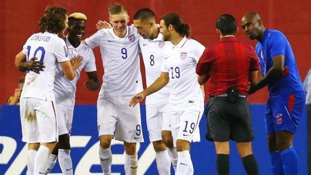 Clint Dempsey and the USMNT celebrating his goal in their 1-0 win over Haiti. (Photo: Twitter/SI)