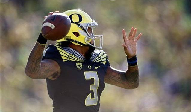 Once an Eastern Washington Eagle, Vernon Adams Jr. led Oregon to a 61-42 victory over EWU Saturday.(Ryan Kang AP Photo)