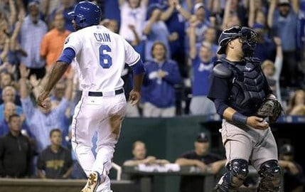 Kansas City Royals' Lorenzo Cain (6) celebrates after scoring the tying run on a sacrifice fly hit by Jarrod Dyson during the ninth inning of a baseball game against the Seattle Mariners Wednesday. (AP Photo/Charlie Ried)