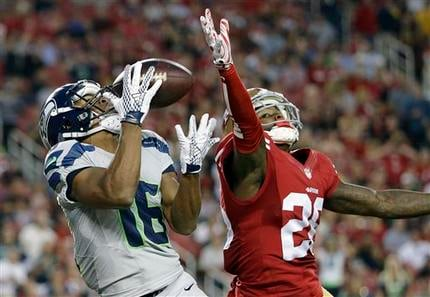 Seattle Seahawks wide receiver Tyler Lockett (16) catches a touchdown pass in front of San Francisco 49ers cornerback Tramaine Brock (26) during the first half. (AP Photo/Marcio Jose Sanchez)