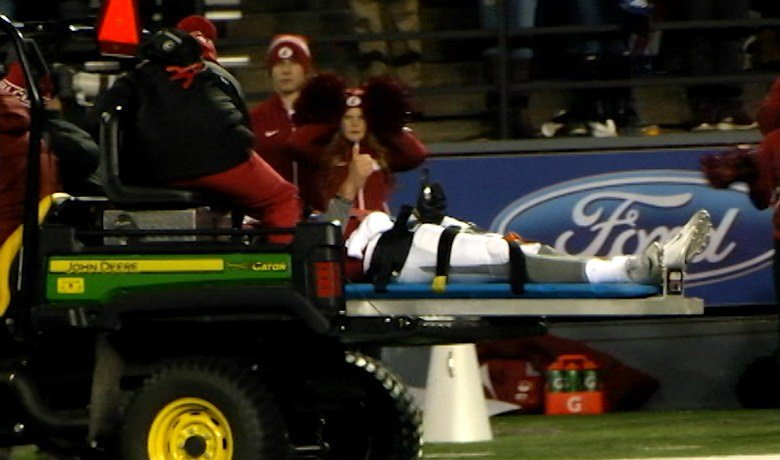 Luke Falk was taken off the field on a backboard with 8:16 left in the third quarter after being sacked by Samson Kafovalu.