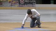 Painters prepare the ice at Spokane Arena following Saturday's Spokane Chiefs hockey game (Photo: SWX)